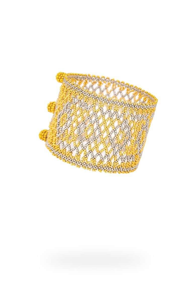 001 brazalete tejido abierto oro platino